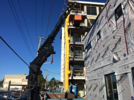 Photo by: Rick G. | A rearmount lifting marble to the 5th floor of this building.