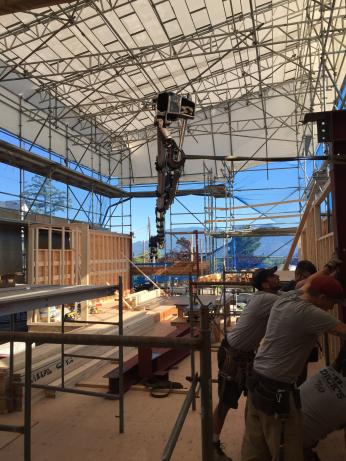 Photo Credit: Morgan B. | Placing steel beams under this enclosed area.