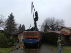 Lifting a hot tub over a client's home and into their backyard.