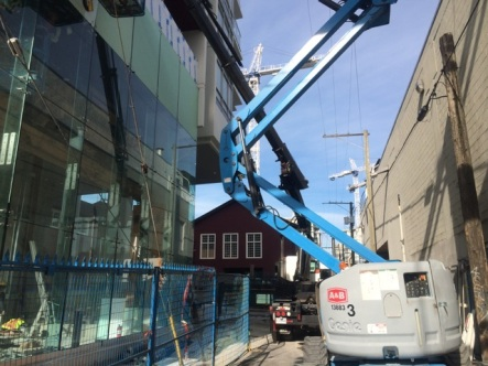 Using our crane to place glass on this building