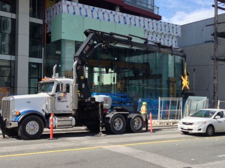 Using our crane to place glass on this building.