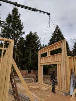 Photo Credit: Mohan V. | Helping build the structure for this house.
