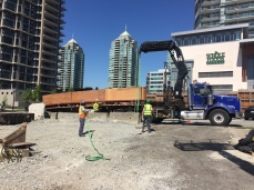 Using a 500 Hiab to deliver windows and window crates to the SOLO Tower in Burnaby.