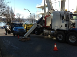 Stinger unloading drywall from Win-Roc's truck and taking it straight to the top of a building on Beach Avenue, Vancouver