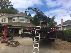 Photo Credit: Sean H. | Moving lumber beams