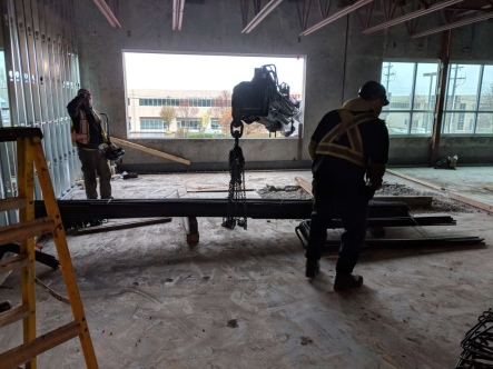Photo Credit: Mohan V. | Lifting and placing steel beams through a window.